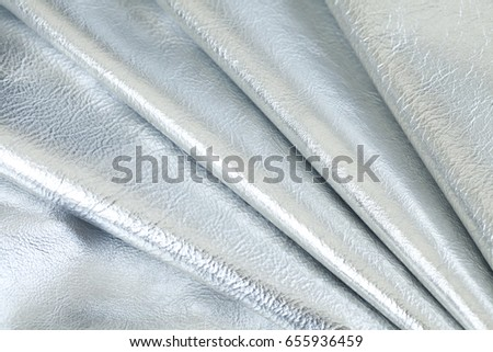 Stocks of a fabric are necessary for manufacture of a garment factory Close up of multicolored rolls of leather. High resolution photo