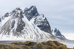Stokksnes  mountains with  black sand dunes in winter. East of Iceland.