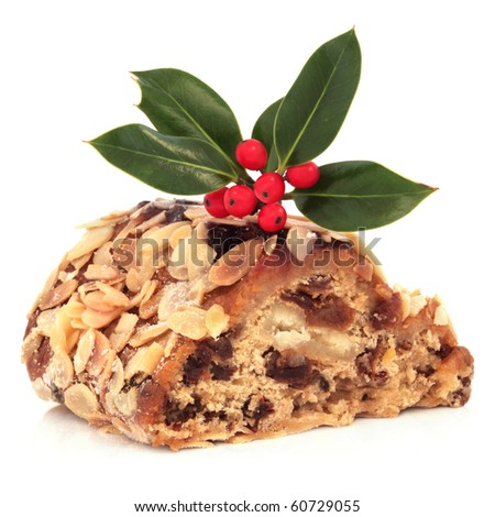 Stollen cake with holly berry leaf sprig, isolated over white background.