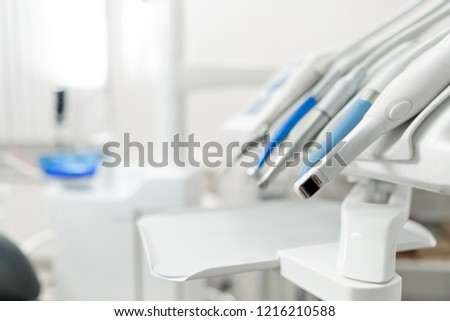 Stomatological instrument in the dentists clinic. Dental work in clinic. Operation, tooth replacement. Medicine, health, stomatology concept. Office where dentist conducts inspection and concludes.
