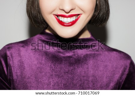 Stomatology commercial. Female with white teeth. Unrecognizable woman with wide smile and red lipstick closeup, oral health care, dental concept