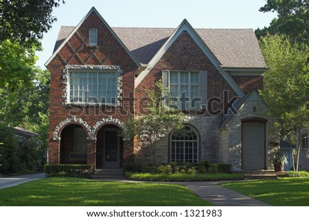 stone and brick duplex with three roof gables