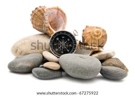 stone and compass on a white background