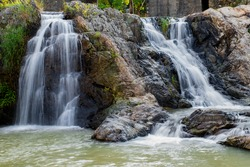 Stone and water, the water of mountain spring is flowing continuously