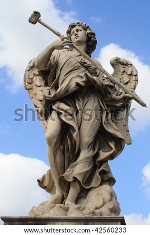 stone angel statue with trumpet