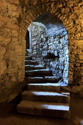 Stone arch and steps in underground castte