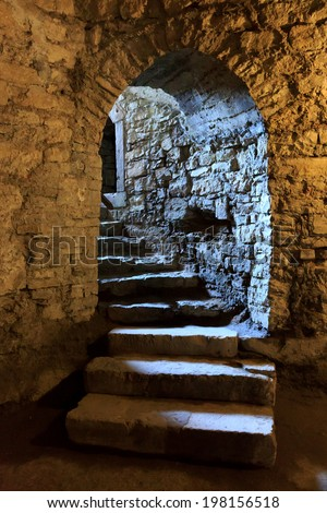 stone arch and steps in underground castte stock photo