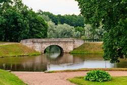 Stone arch bridge across a lake in Gatchina, Russia