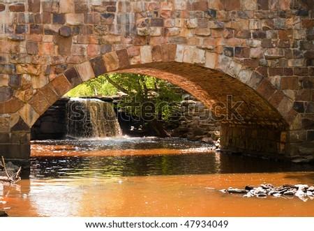 stone arch bridge and waterfall