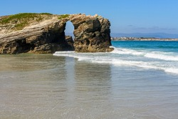 Stone arch on the beach of the cathedrals, famous place in Galicia Spain. Lugo.