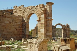 Stone arches, thousands of years old built at the ancient Roman city of Leptis Magna in northern Libya.