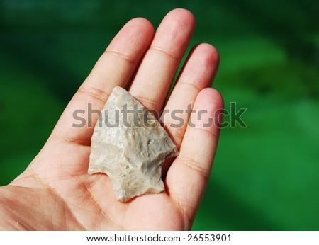 stone arrowhead in hand