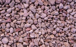 Stone background. blue gravel. Granite texture. The rocky road. Fine pebbles. Construction material. The texture of the stones. Wallpaper with fine gravel. defocused