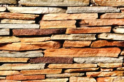 Stone background shale laid with layers of brown color of heterogeneous structure