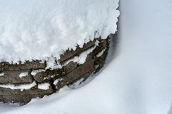 Stone bard in the snow. Winter concept.
