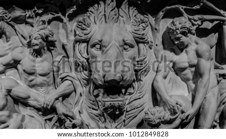 stone bas relief of lion and...