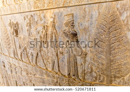Stone bas-relief of residents of historical empire with animals carved on the stairway facade of the Apadana at the old city Persepolis. #520671811