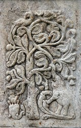 Stone bas-relief with tree, peacock and elephant on wall of Sri Dalada Maligawa (Temple of tooth relic, Temple of Buddha tooth), Kandy, Sri Lanka. UNESCO world heritage site