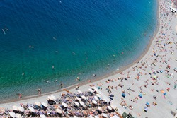 stone beach and turquiose water of cote dAzur at Nice at summer, Riviera, France, top view