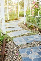 stone block pathway in flower garden