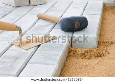 Stone blocks laying down on sand
