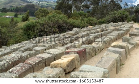 Stone blocks lined up by archaeologists, for the reconstruction of the Incan ruins of Ingapirca outside of Cuenca, Ecuador