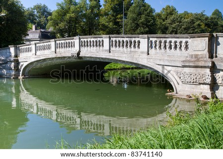 "Stone bridge crossing the ""Nymphenburg"" canal in Munich, Germany"