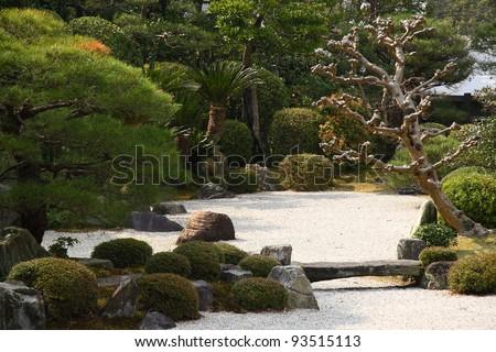 Stone bridge in a zen garden in Kyoto (Japan)