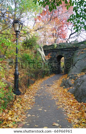 Stone bridge in Autumn in New York City Central park.