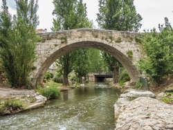 stone bridge of a village in Spain