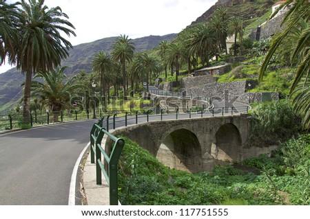 Stone bridge over the Valle Gran Rey on the island of La Gomera. La Gomera has a unique nature that invites to hiking. Gomera is one of the most beautiful Canary Islands