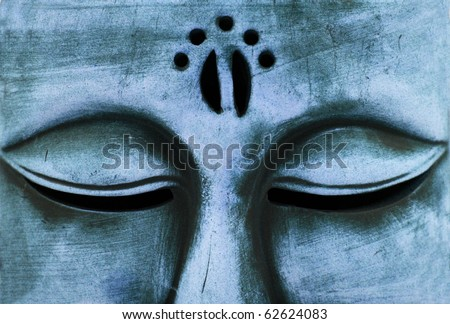 stone buddha statue - close up of eyes