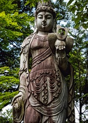 Stone Buddhist Statue in Natural Forest Setting. Summer Day. Close Up, No People (Tsumago, Kiso Valley, Japan).