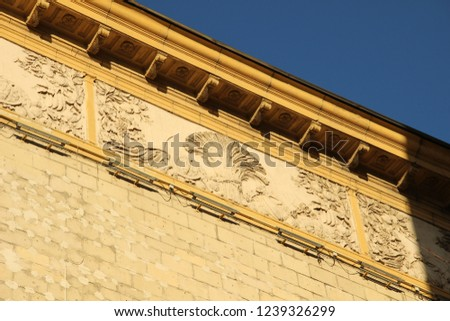 Stone building decoration bas-relief ander roof and blue sky