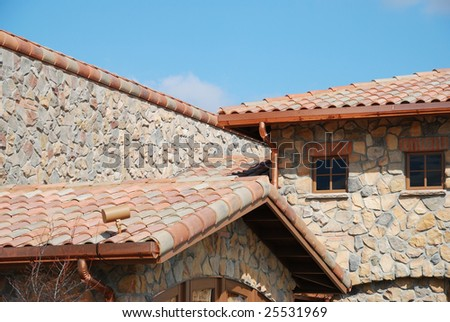 stone building exterior with beautiful roof