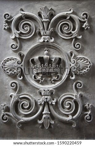 Stone carved coat of arms on entrance of The Residenz in Munich, Bavaria, Germany