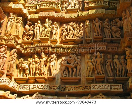 Stone carved erotic sculptures in Hindu temple in Khajuraho, Madhya Pradesh, India