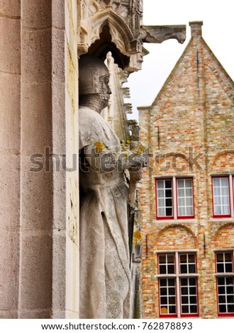 stone carved figur of the townhall in damme #762878893