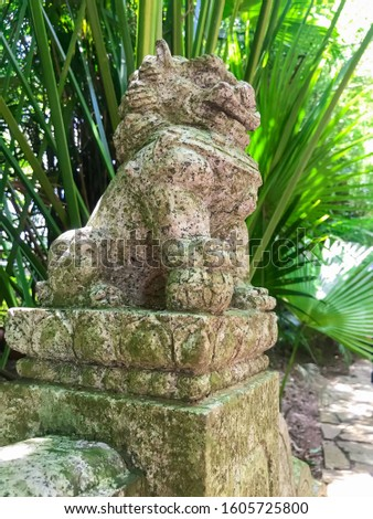 stone Chinese LION-guard. traditional mythical character. Sculpture in the Longevity Valley in Nanshan Park. Sanya, Hainan, China