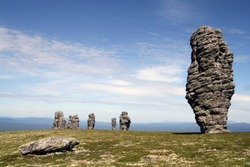 Stone columns of weathering on the mountain plateau Manpupuner in the Republic of Komi in Russia
