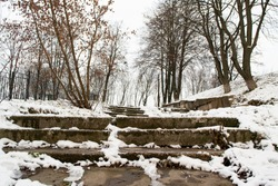 Stone concrete snow covered stairs in the city at winter. Stairway to heaven. Black and white