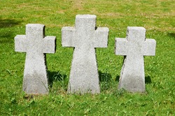 Stone cross on the grass