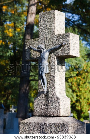Stone cross with metal figurine of jesus christ