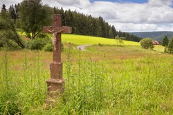 Stone crucifix by the road in the Black Forest mountains.