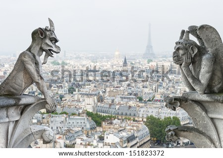 Stone demons gargoyle and chimera with Paris city on background. View from Notre Dame de Paris