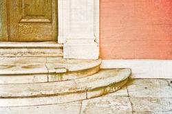 Stone door steps at the entrance of a mansion, textured image with retro filter applies