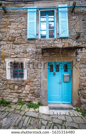 Stone facades of old houses in ancient streets. The Groznjan village on Istria in Croatia, Europe.