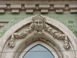 Stone face of woman on facade of a building
