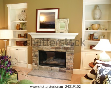 Stone fireplace in a modern living room with a white painted wooden mantle. Artwork has been replaced with art that I own the copyright to.