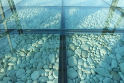 Stone floor with glass